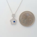9K SOLID WHITE GOLD 45CM NECKLACE WITH NATURAL SAPPHIRE AND 25 DIAMOND PENDANT.