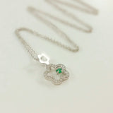 9K SOLID WHITE GOLD 45CM NECKLACE WITH NATURAL EMERALD AND 25 DIAMOND PENDANT.