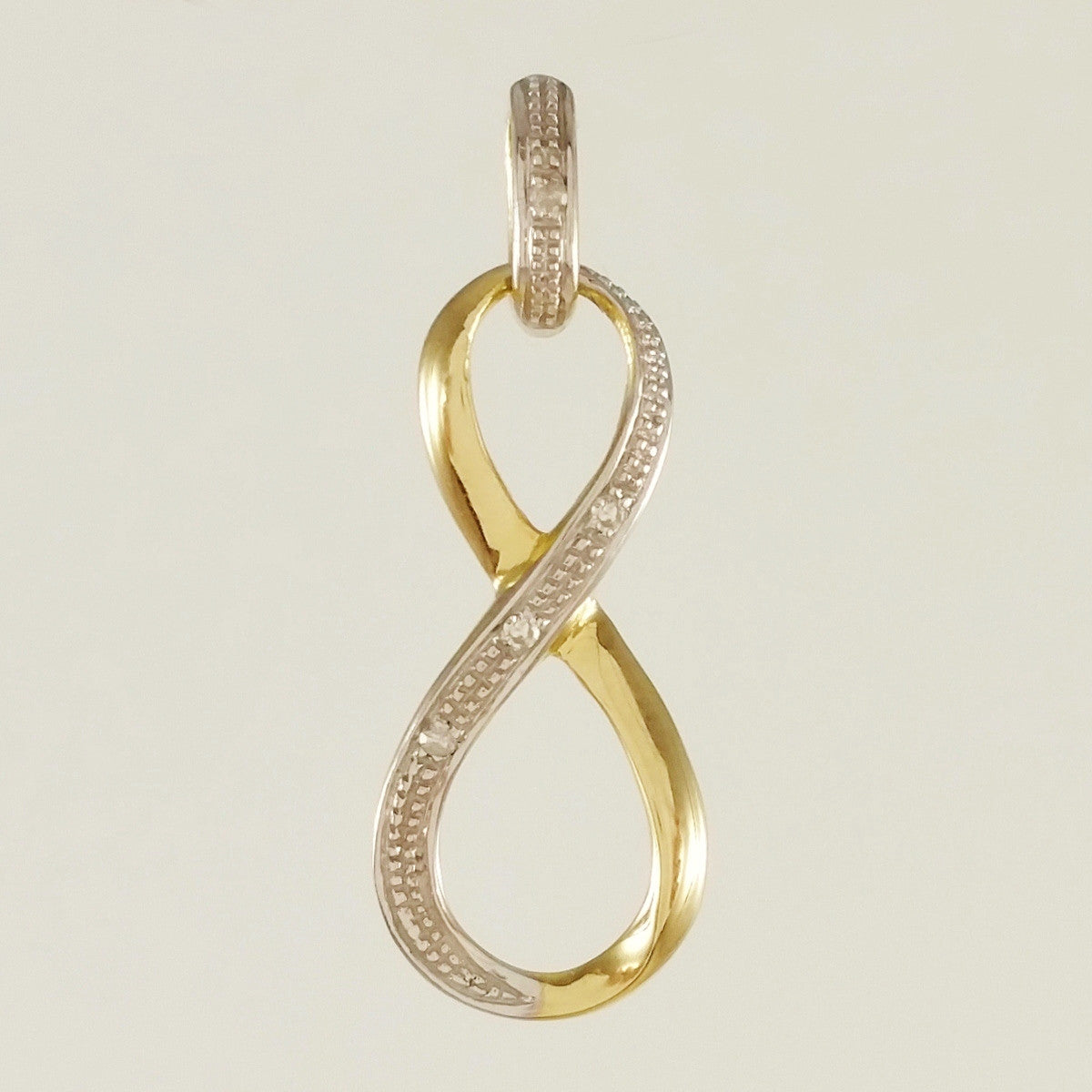 9K SOLID GOLD 0.02CT INFINITY ETERNITY PENDANT WITH 4 DIAMONDS.