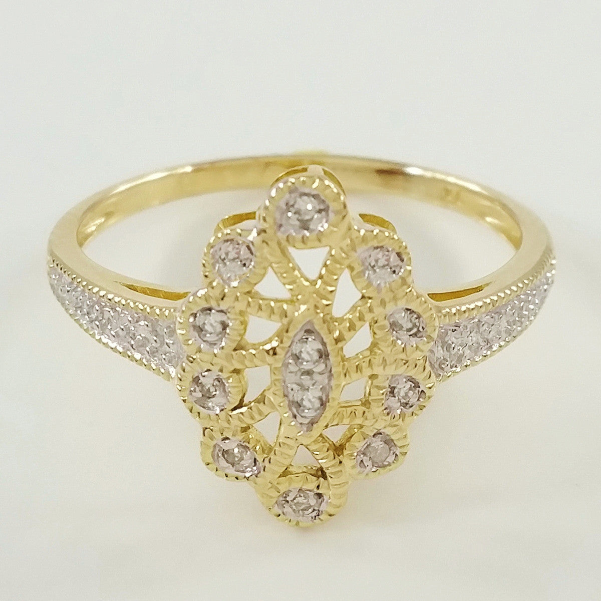 9K SOLID GOLD ART DECO INSPIRED NAVETTE RING WITH 12 DIAMONDS.
