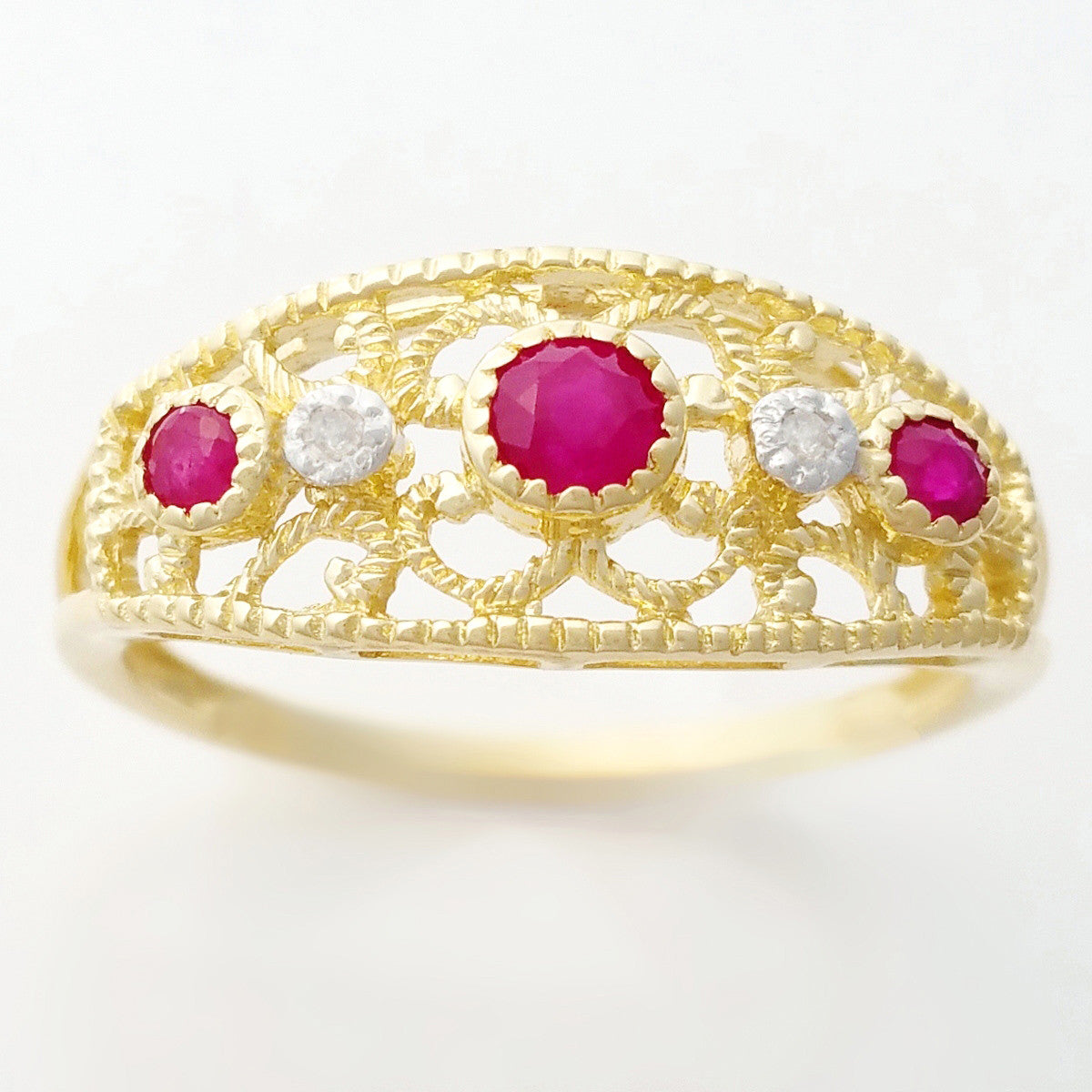 9K SOLID GOLD 0.30CT NATURAL RUBY NAVETTE STYLE RING WITH 2 DIAMONDS.