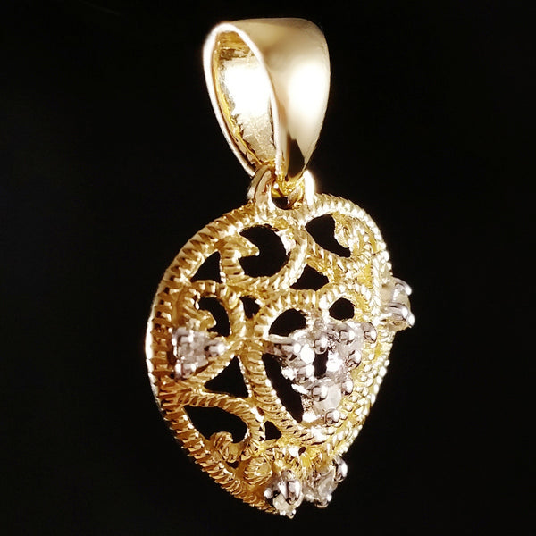 9K SOLID GOLD FILIGREE HEART PENDANT WITH 7 DIAMONDS.