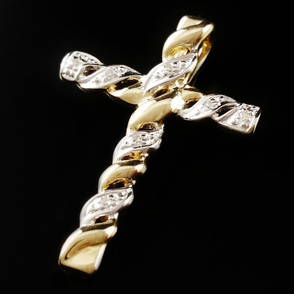 9K SOLID GOLD CROSS PENDANT WITH 7 DIAMONDS.