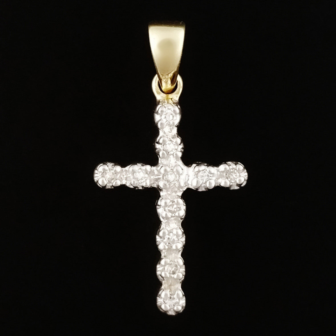 9K SOLID GOLD CROSS PENDANT WITH 11 DIAMONDS.
