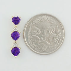 9K SOLID GOLD 0.70CT NATURAL AMETHYST PENDANT WITH 2 DIAMONDS.