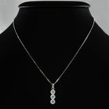 925 STERLING SILVER NECKLACE WITH TRILOGY EVIL EYE PENDANT SET IN SPARKLING CRYSTALS.