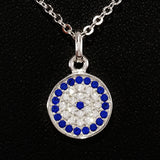 925 STERLING SILVER NECKLACE WITH ROUND EVIL EYE PENDANT SET IN SPARKLING CRYSTALS.