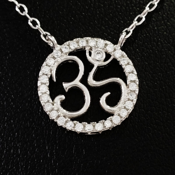 925 STERLING SILVER NECKLACE WITH OM NAMASTE PENDANT SET IN SPARKLING CRYSTALS.