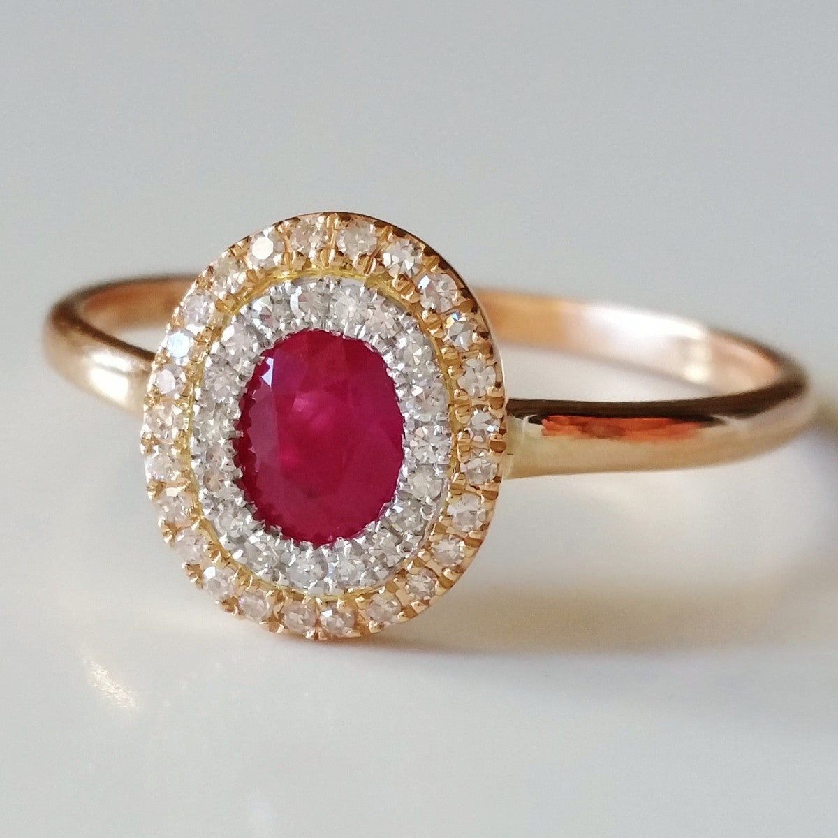9K SOLID ROSE GOLD 0.55CT NATURAL RUBY HALO RING WITH 43 DIAMONDS.