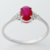 9K SOLID WHITE GOLD 0.60CT NATURAL OVAL RUBY RING WITH 6 DIAMONDS.