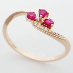 9K SOLID ROSE GOLD 0.20CT NATURAL RUBY CLUSTER RING WITH 8 DIAMONDS.