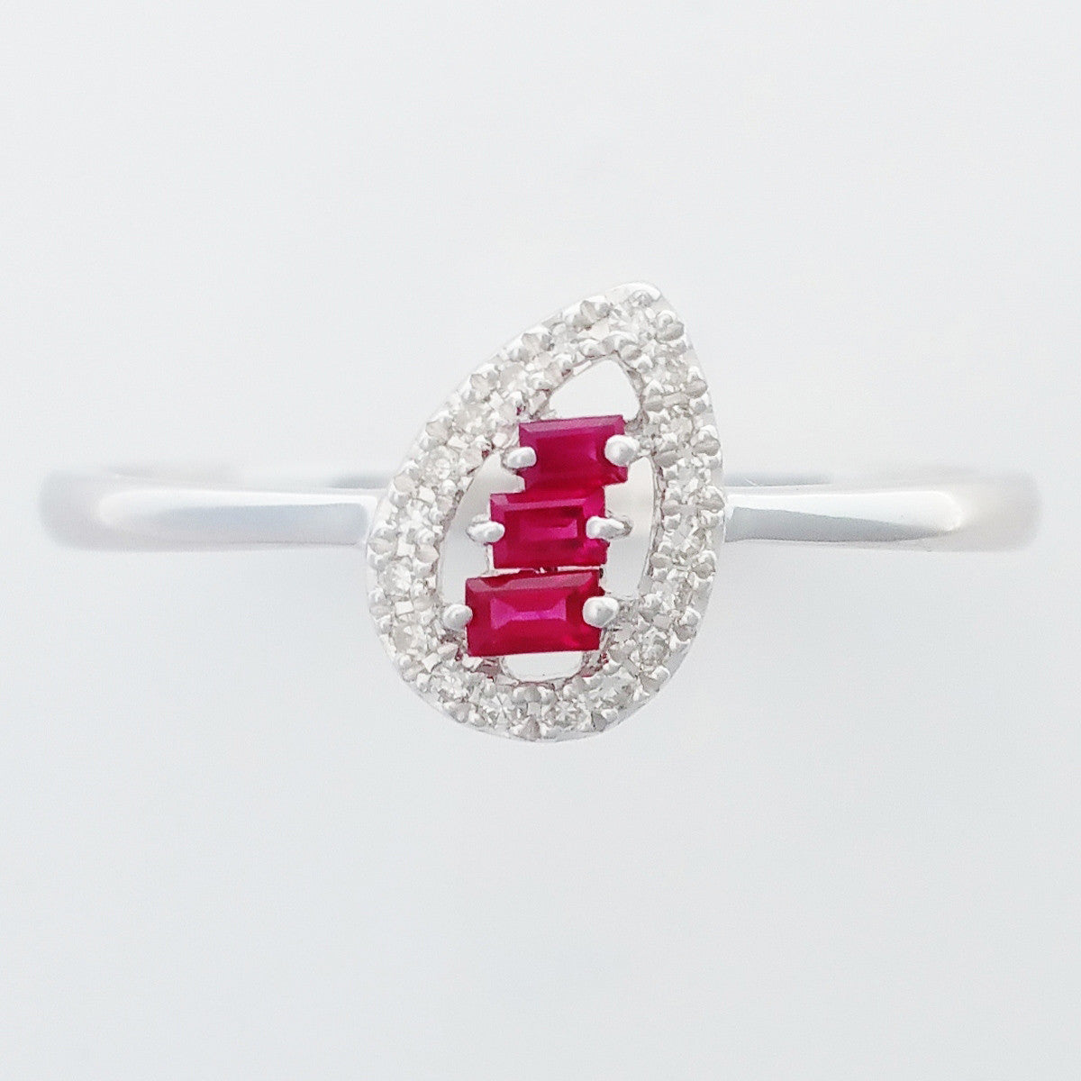 9K SOLID WHITE GOLD NATURAL BAGUETTE RUBY RING WITH 18 DIAMONDS.