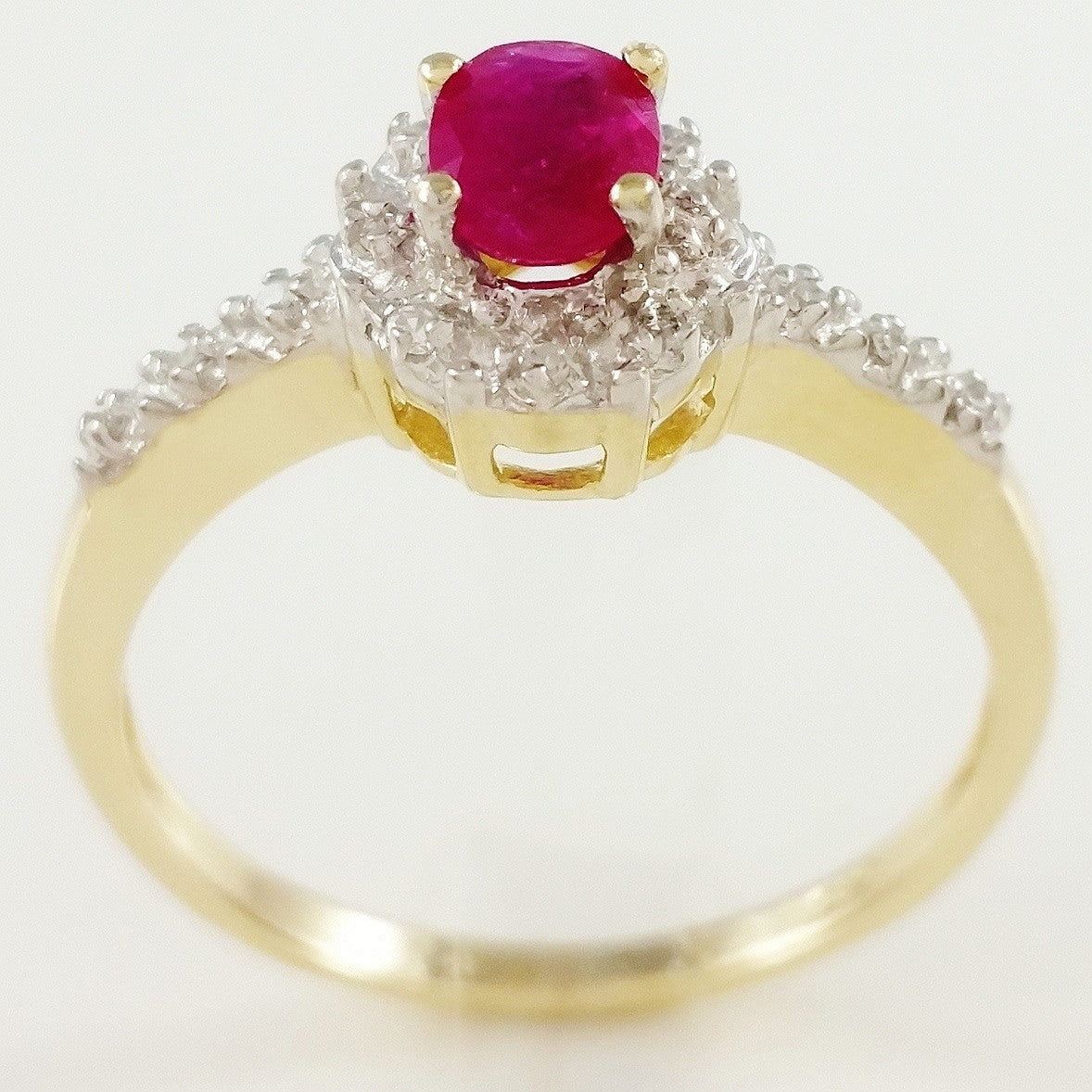 9K SOLID GOLD VINTAGE INSPIRED 0.50CT NATURAL RUBY RING WITH 14 DIAMONDS.