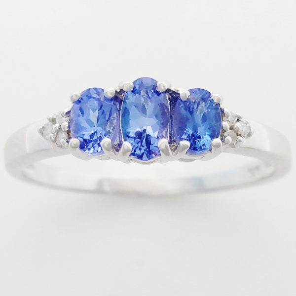 9K SOLID WHITE GOLD 0.60CT NATURAL TANZANITE TRILOGY RING WITH 6 DIAMONDS.
