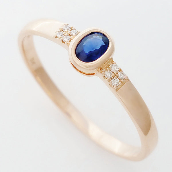 9K SOLID ROSE GOLD 0.20CT NATURAL OVAL BLUE SAPPHIRE RING WITH 8 DIAMONDS.