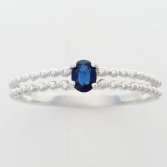 9K SOLID WHITE GOLD 0.25CT NATURAL SAPPHIRE RING WITH BEADED SHOULDERS.