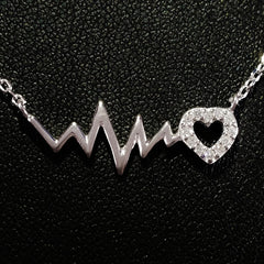 925 STERLING SILVER NECKLACE WITH EKG HEARTBEAT AND CRYSTAL LOVE-HEART PENDANT.