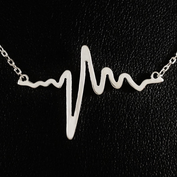925 STERLING SILVER NECKLACE WITH SOLID SILVER EKG HEARTBEAT CHARM PENDANT.