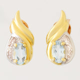 9K SOLID GOLD 0.65CT SKY BLUE TOPAZ AND DIAMOND STUD EARRINGS.