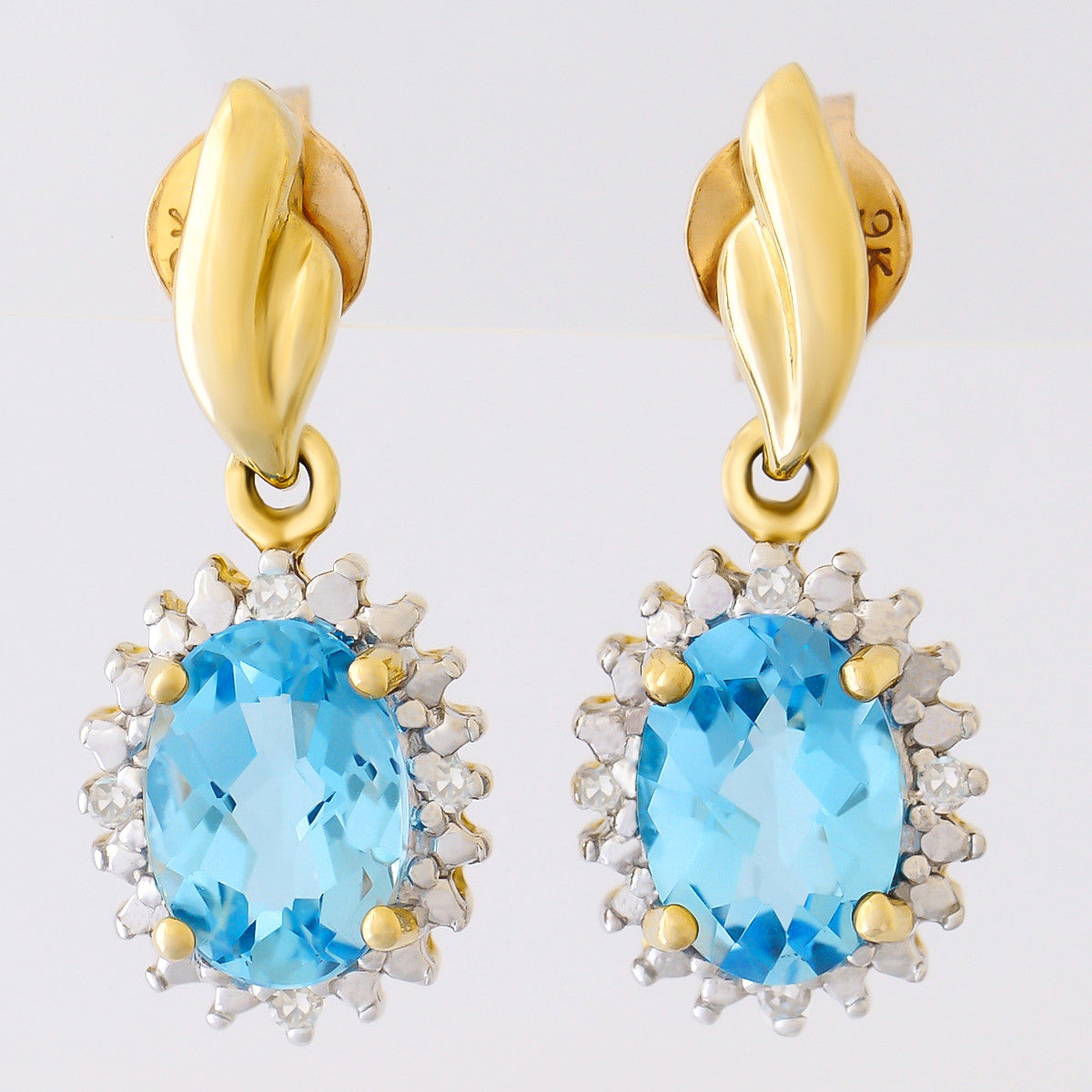 9k Solid Gold 170ct Swiss Blue Topaz Earrings With Eight Diamonds
