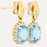9K SOLID GOLD 1.70CT SWISS BLUE TOPAZ EARRINGS WITH EIGHT DIAMONDS.