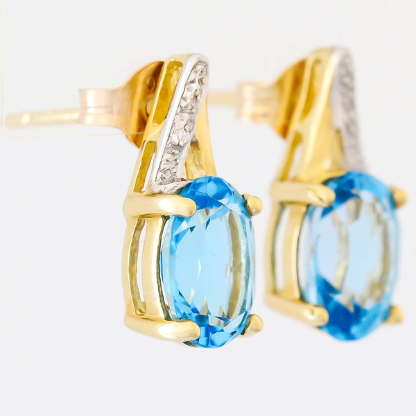 9K SOLID GOLD 3.10CT SWISS BLUE TOPAZ AND DIAMOND EARRINGS.