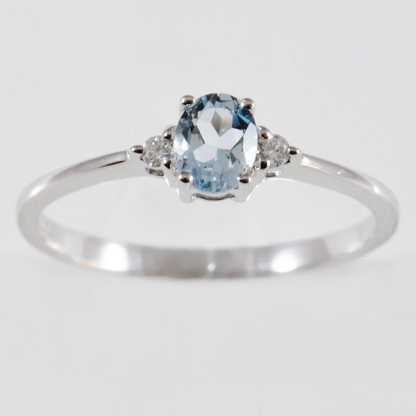 9K SOLID WHITE GOLD 0.30CT NATURAL OVAL AQUAMARINE RING WITH 2 DIAMONDS.