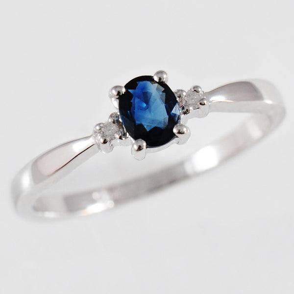 9K SOLID WHITE GOLD 0.40CT NATURAL OVAL BLUE SAPPHIRE RING WITH 2 DIAMONDS.