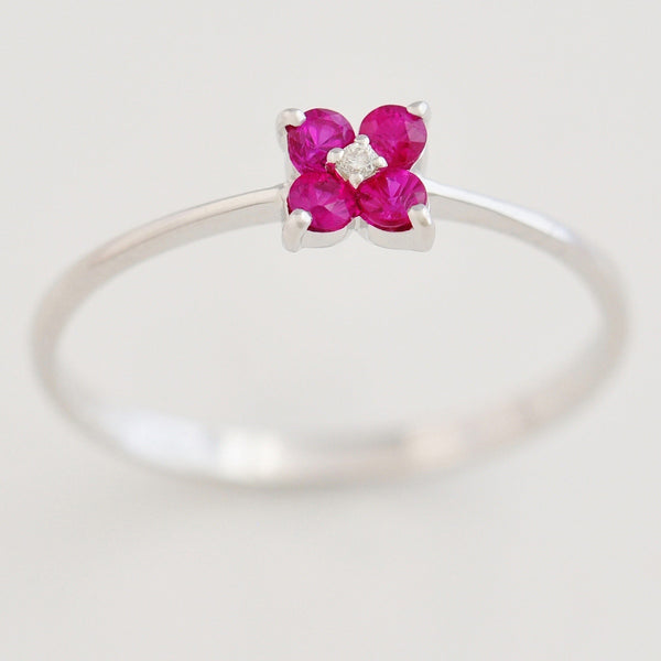9K SOLID WHITE GOLD 0.20CT RUBY FLORAL CLUSTER RING WITH CENTRE DIAMOND.