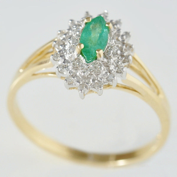 9K SOLID GOLD VINTAGE INSPIRED 0.25CT MARQUISE EMERALD RING WITH 28 DIAMONDS.
