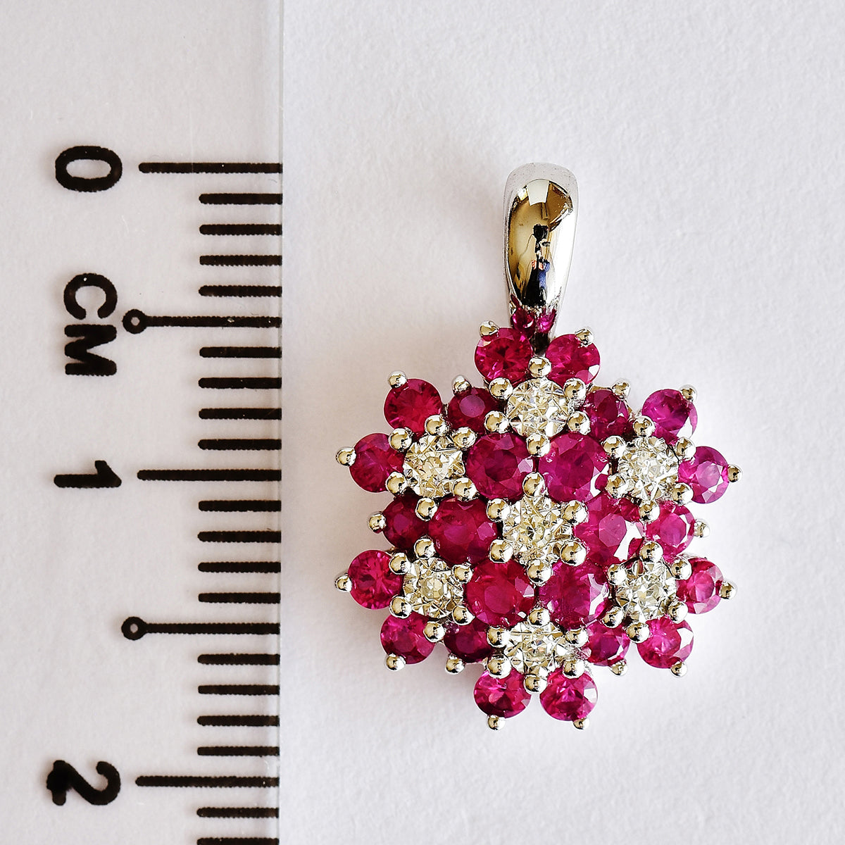 9K SOLID WHITE GOLD 0.85CT NATURAL RUBY CLUSTER PENDANT WITH SEVEN DIAMONDS.