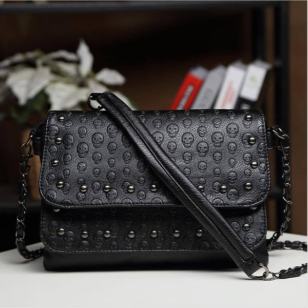 Embossed Skulls Shoulder Bag