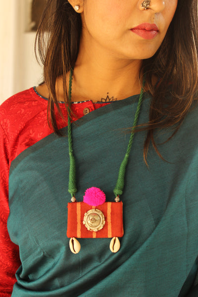Adjustable dori necklace with antique pendant and pompom. CC-CH1B-C2