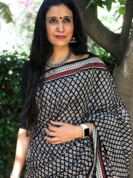 | Pecans | Black Traditional Dabu Handblock printed Cotton saree.