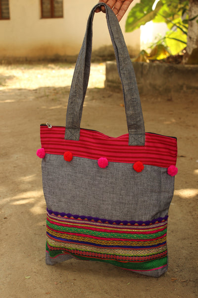 Multicolor zari tote with pompoms. CC-ZT1-C2