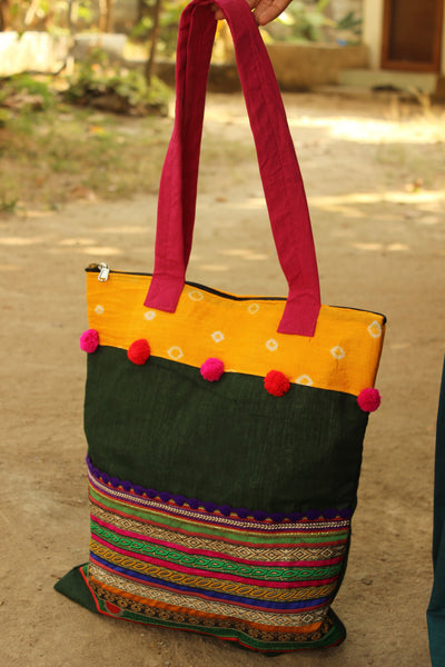 Multicolor zari tote with pompoms. CC-ZT2-C2