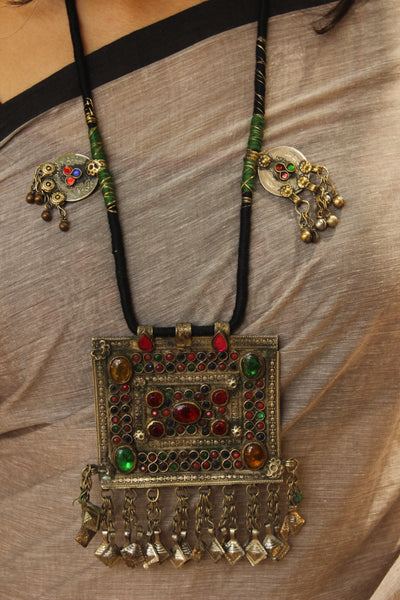 Handcrafted adjustable afghan pendant necklace. CC-BAF1-C7