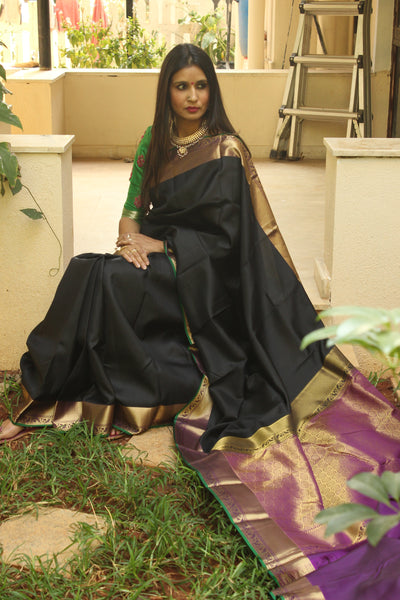 | Black Lotus | Black Pure Kanjeevaram silk handloom saree  zari and heavy pallu.