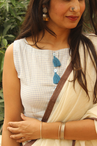 White and Blue Checked Sleeveless ready to wear cotton Blouse with tassels .