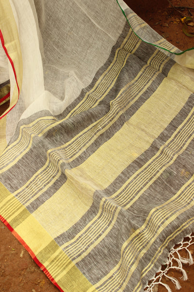 Off White linen saree with zari border.