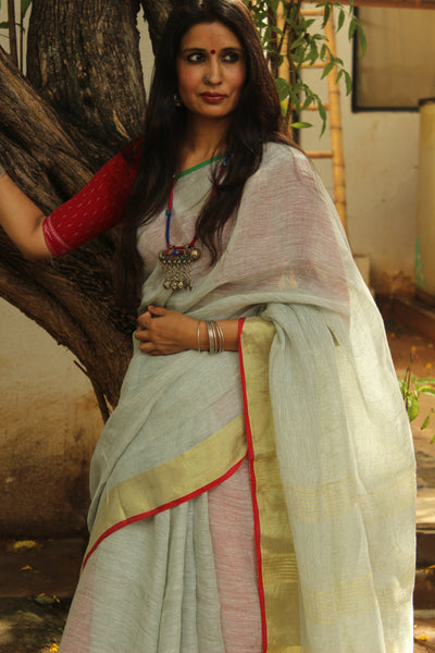 Light Grey linen saree with zari border.
