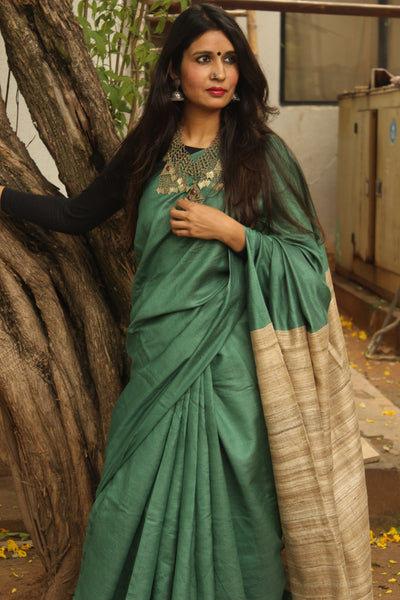 | Classy | - Green Staple Viscose saree with pure tussar palla.