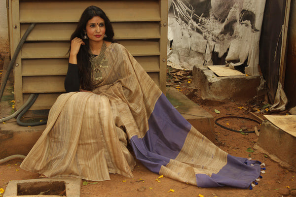 | Purples and Beiges | - Pure tussar silk saree in beige.