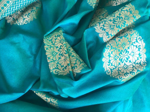 Green Benarasi Semi katan silk saree with round zari motifs zari and heavy pallu.