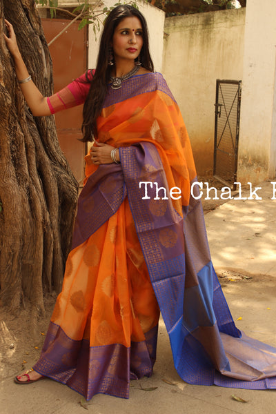 Orange Benarasi kora muslin saree with blue handwoven border. TCB-KA5-C2