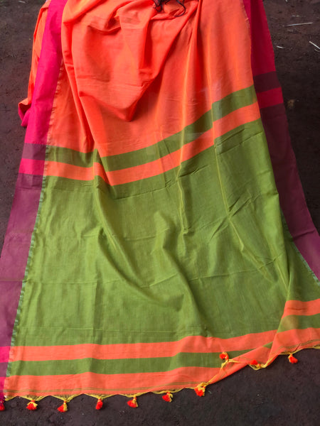 | Saffron | - Orange cotton Saree with contrast pink border with thin zari.