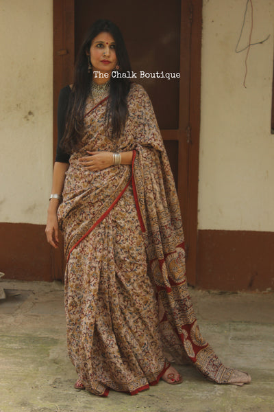 Beige and Red Overall soft cotton kalamkari saree with thin border.
