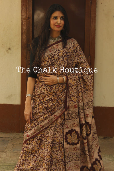 Beige and Brown Overall soft cotton kalamkari saree with thin border.