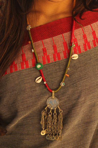 Handcrafted necklace with antique coin pendant.CC-DNP3-C3