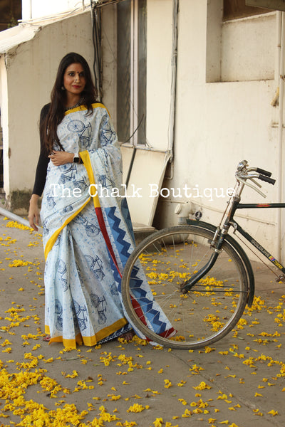 | On the saddle | 'Cycles' hand block printed dabu saree with yellow border. TCB-MUL4-RB4-The Chalk Boutique